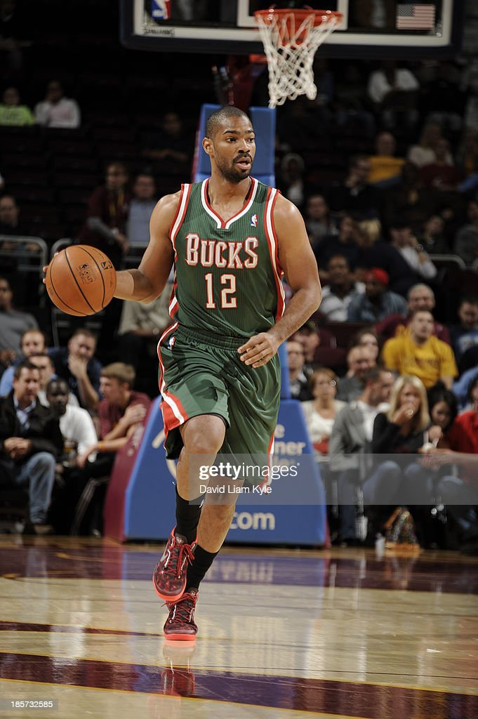 <a gi-track='captionPersonalityLinkClicked' href=/galleries/search?phrase=Gary+Neal&family=editorial&specificpeople=5085165 ng-click='$event.stopPropagation()'>Gary Neal</a> #12 of the Milwaukee Bucks brings the ball up court against the Cleveland Cavaliers at The Quicken Loans Arena on October 8, 2013 in Cleveland, Ohio.