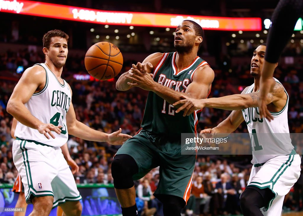 Gary Neal #12 of the Milwaukee Bucks has the ball stripped from him by Courtney Lee #11 of the Boston Celtics in the second half during the game at TD Garden on December 3, 2013 in Boston, Massachusetts.