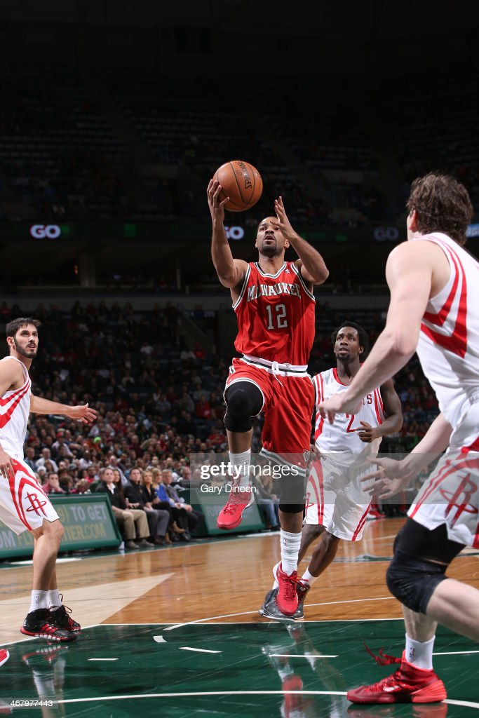 Gary Neal #12 of the Milwaukee Bucks shoots against the Houston Rockets on February 8, 2014 at the BMO Harris Bradley Center in Milwaukee, Wisconsin.