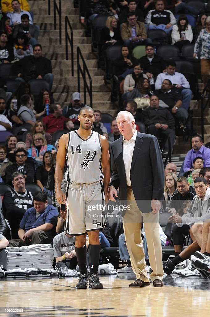 Gary Neal #14 of the San Antonio Spurs and Head Coach Gregg Popovich of the San Antonio Spurs confer during the game between the Philadelphia 76ers and the San Antonio Spurs on January 5, 2013 at the AT&T Center in San Antonio, Texas.