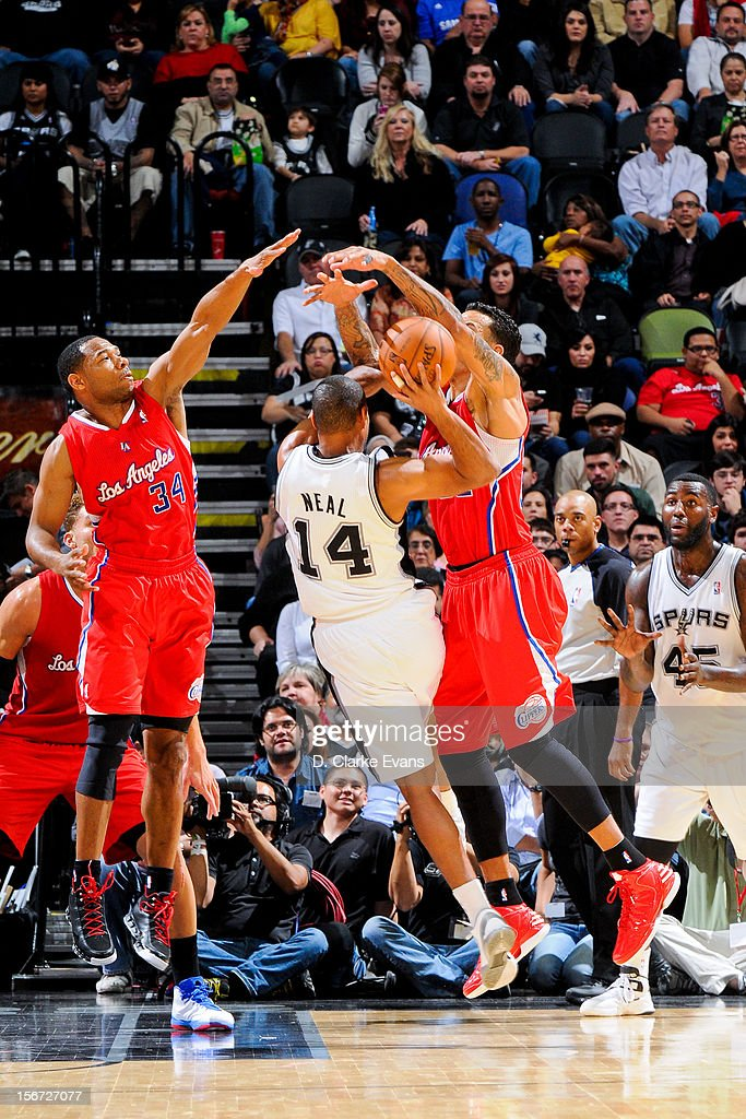 Gary Neal #14 of the San Antonio Spurs attempts to pass the ball against Willie Green #34 and Matt Barnes #22 of the Los Angeles Clippers on November 19, 2012 at the AT&T Center in San Antonio, Texas.