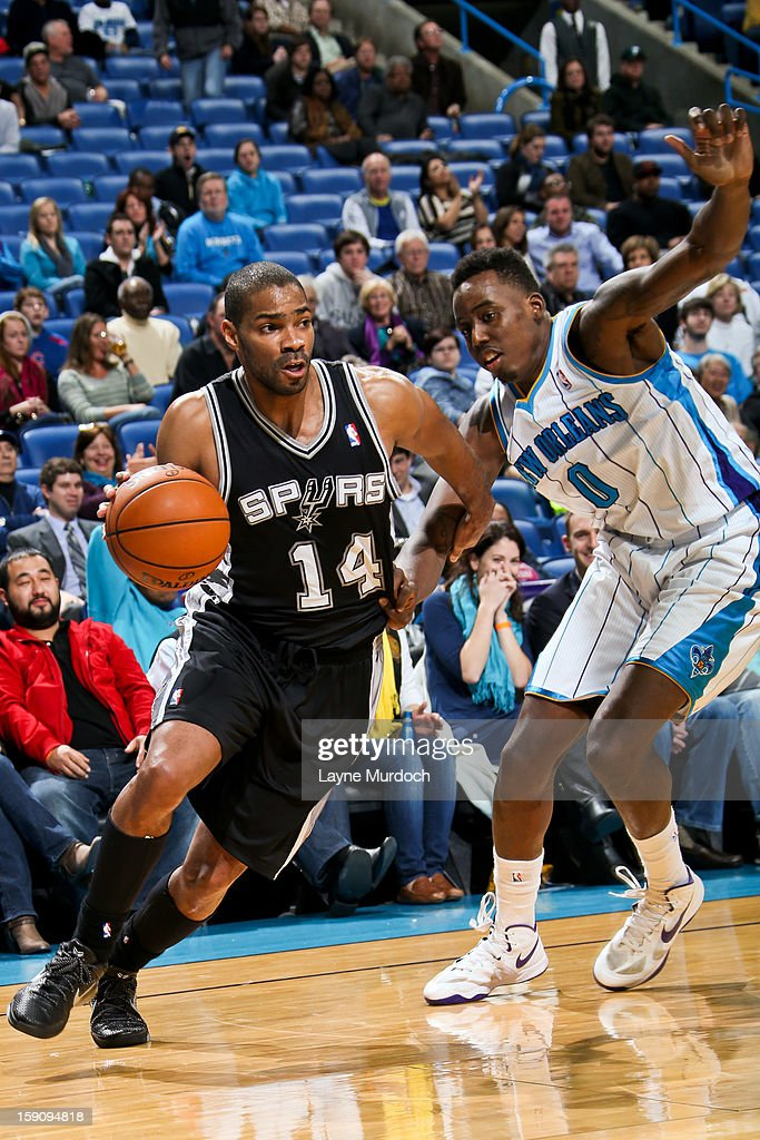 Gary Neal #14 of the San Antonio Spurs drives against Al-Farouq Aminu #0 of the New Orleans Hornets on January 7, 2013 at the New Orleans Arena in New Orleans, Louisiana.