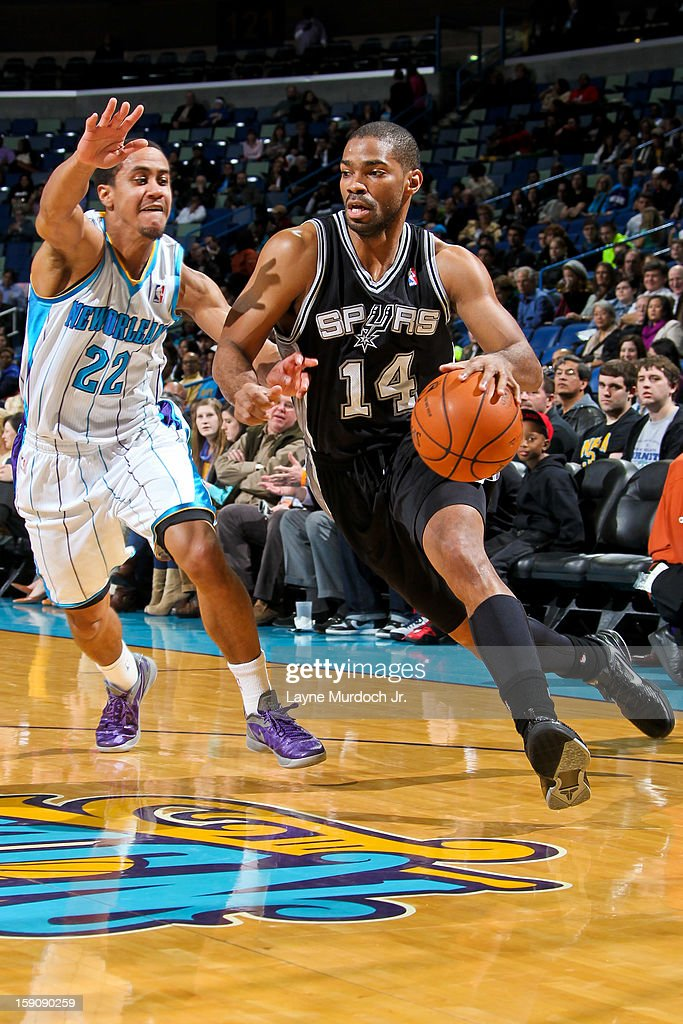 Gary Neal #14 of the San Antonio Spurs drives against Brian Roberts #22 of the New Orleans Hornets on January 7, 2013 at the New Orleans Arena in New Orleans, Louisiana.