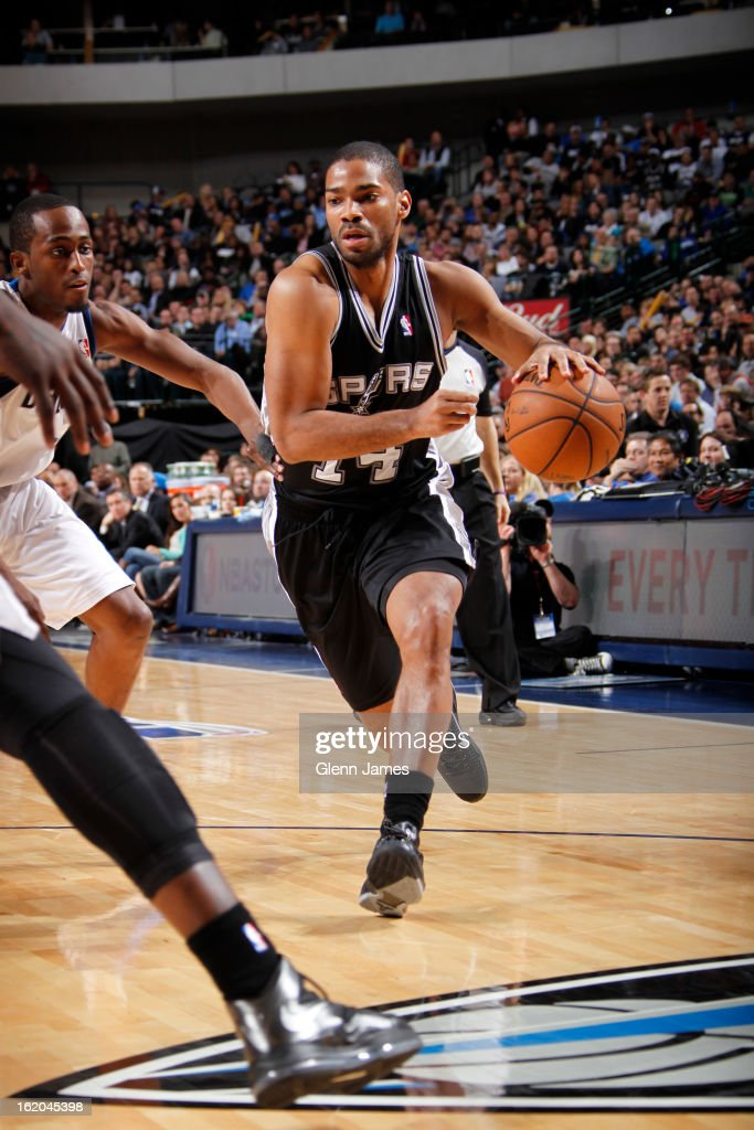 Gary Neal #14 of the San Antonio Spurs drives to the basket against the Dallas Mavericks on January 25, 2013 at the American Airlines Center in Dallas, Texas.