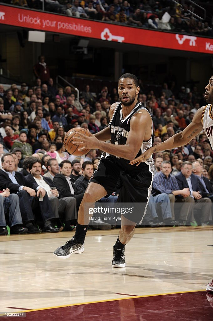 <a gi-track='captionPersonalityLinkClicked' href=/galleries/search?phrase=Gary+Neal&family=editorial&specificpeople=5085165 ng-click='$event.stopPropagation()'>Gary Neal</a> #14 of the San Antonio Spurs drives to the basket against the Cleveland Cavaliers at The Quicken Loans Arena on February 13, 2013 in Cleveland, Ohio.