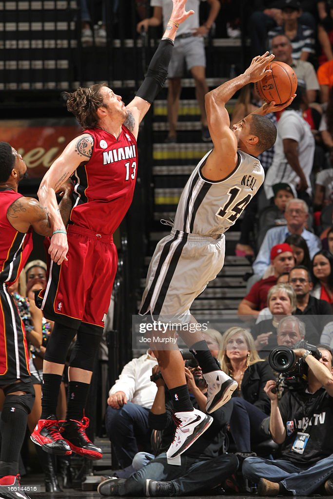 Gary Neal #14 of the San Antonio Spurs faces Mike Miller #13 of the Miami Heat during the game between the Miami Heat and the San Antonio Spurs on March 31, 2013 at the AT&T Center in San Antonio, Texas.
