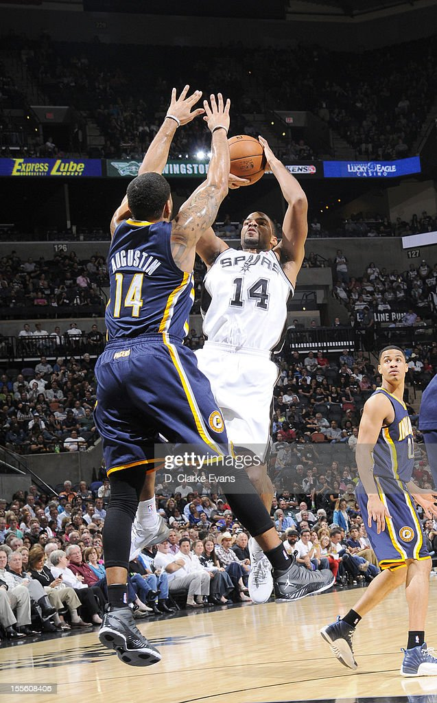 <a gi-track='captionPersonalityLinkClicked' href=/galleries/search?phrase=Gary+Neal&family=editorial&specificpeople=5085165 ng-click='$event.stopPropagation()'>Gary Neal</a> #14 of the San Antonio Spurs goes for a jump shot against <a gi-track='captionPersonalityLinkClicked' href=/galleries/search?phrase=D.J.+Augustin&family=editorial&specificpeople=3847521 ng-click='$event.stopPropagation()'>D.J. Augustin</a> #14 of the Indiana Pacers during the game between the Indiana Pacers and the San Antonio Spurs on November 5, 2012 at the AT&T Center in San Antonio, Texas.
