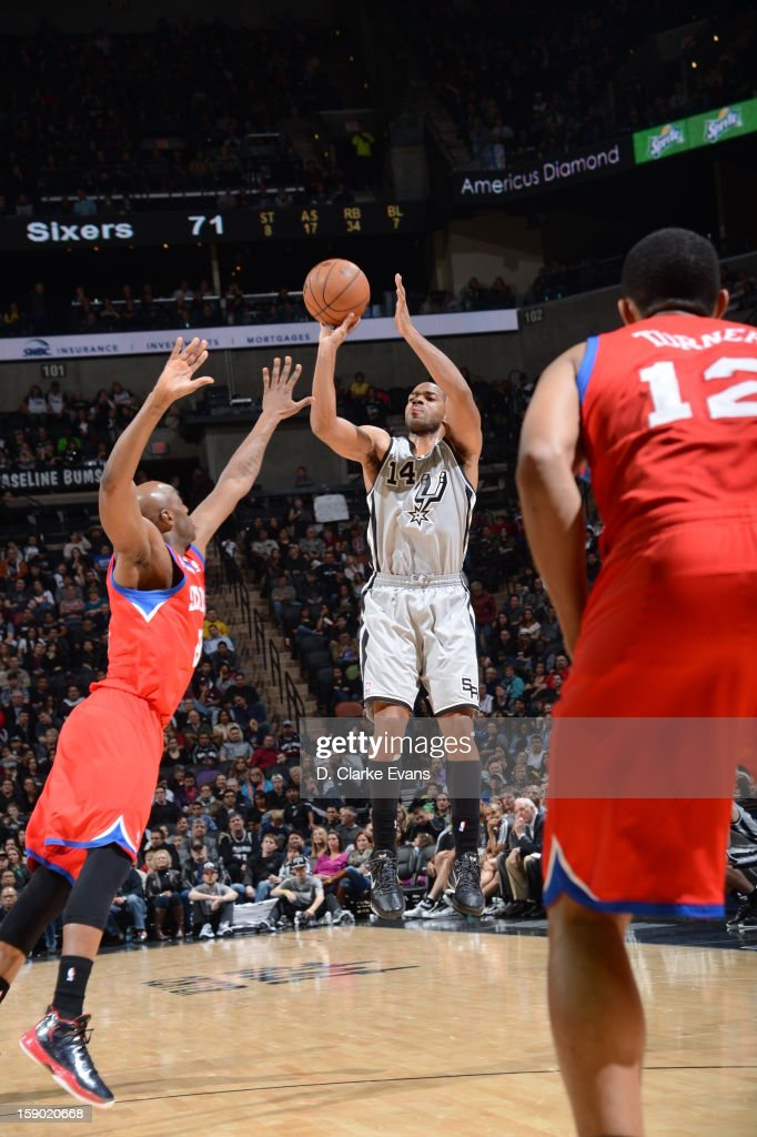 <a gi-track='captionPersonalityLinkClicked' href=/galleries/search?phrase=Gary+Neal&family=editorial&specificpeople=5085165 ng-click='$event.stopPropagation()'>Gary Neal</a> #14 of the San Antonio Spurs goes for a jump shot during the game between the Philadelphia 76ers and the San Antonio Spurs on January 5, 2013 at the AT&T Center in San Antonio, Texas.
