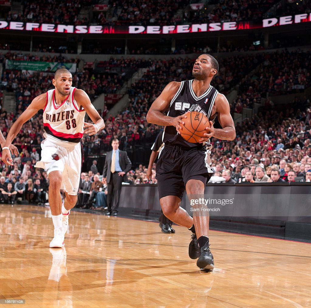 Gary Neal #14 of the San Antonio Spurs handles the ball against Nicolas Batum #88 of the Portland Trail Blazers on November 10, 2012 at the Rose Garden Arena in Portland, Oregon.
