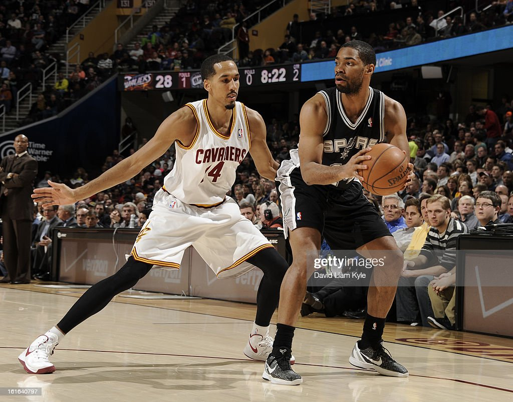 Gary Neal #14 of the San Antonio Spurs protects the ball from Shaun Livingston #14 of the Cleveland Cavaliers at The Quicken Loans Arena on February 13, 2013 in Cleveland, Ohio.