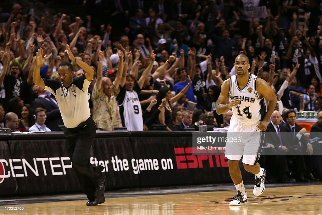<a gi-track='captionPersonalityLinkClicked' href=/galleries/search?phrase=Gary+Neal&family=editorial&specificpeople=5085165 ng-click='$event.stopPropagation()'>Gary Neal</a> #14 of the San Antonio Spurs reacts after making a three-pointer in the fourth quarter while taking on the Miami Heat during Game Three of the 2013 NBA Finals at the AT&T Center on June 11, 2013 in San Antonio, Texas.