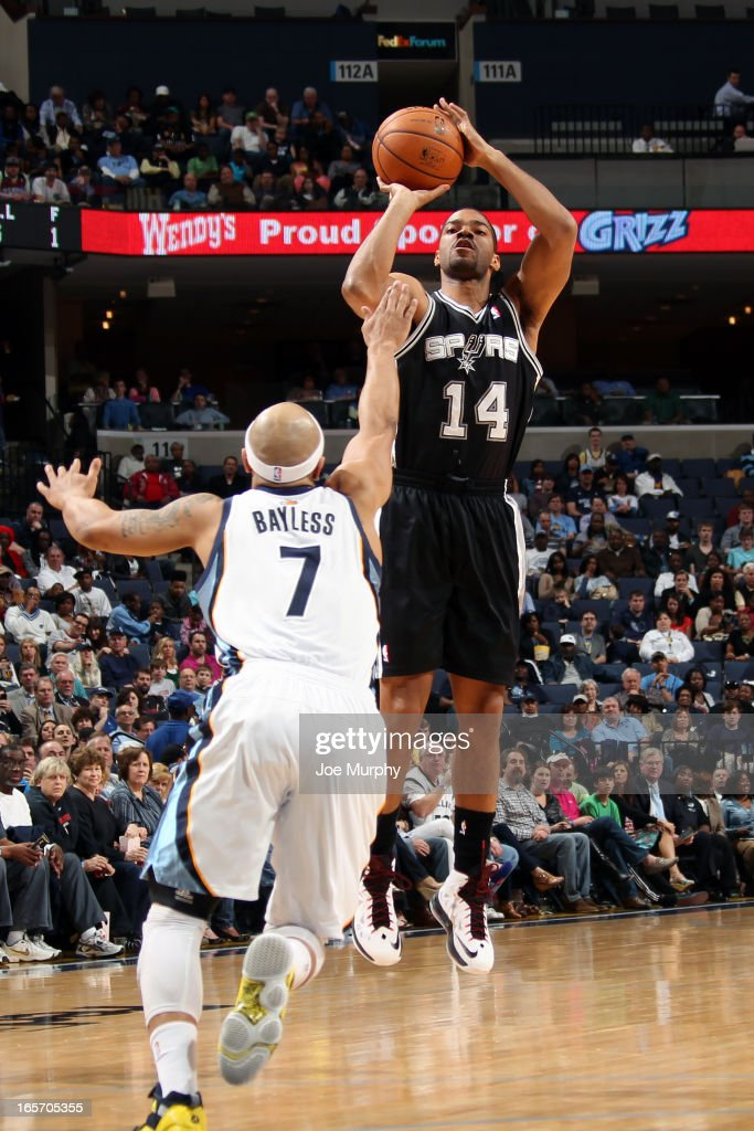 <a gi-track='captionPersonalityLinkClicked' href=/galleries/search?phrase=Gary+Neal&family=editorial&specificpeople=5085165 ng-click='$event.stopPropagation()'>Gary Neal</a> #14 of the San Antonio Spurs takes a shot against the Memphis Grizzlies on April 1, 2013 at FedExForum in Memphis, Tennessee.