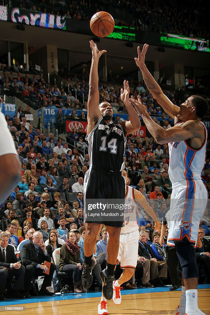 <a gi-track='captionPersonalityLinkClicked' href=/galleries/search?phrase=Gary+Neal&family=editorial&specificpeople=5085165 ng-click='$event.stopPropagation()'>Gary Neal</a> #14 of the San Antonio Spurs throws up a shot against the Oklahoma City during an NBA game on December 17, 2012 at the Chesapeake Energy Arena in Oklahoma City, Oklahoma.