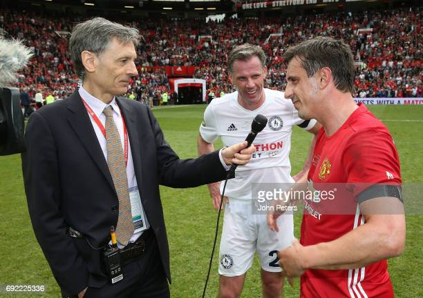 Gary Neville and Jamie Carragher are interviewed after the Michael Carrick Testimonial match between Manchester United '08 XI and Michael Carrick...