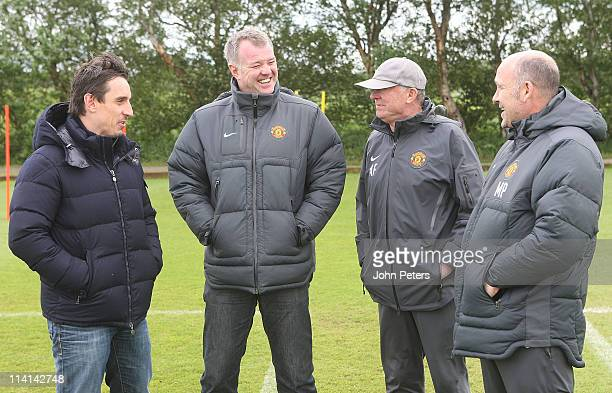 Gary Neville Gary Pallister Sir Alex Ferguson and Mike Phelan of Manchester United share a joke during a first team training session at Carrington...