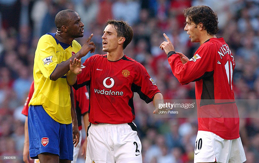 Gary Neville holds Patrick Vieira and Ruud van Nistelrooy apart prior to Vieira being sent off during the FA Barclaycard Premiership match between Manchester United v Arsenal at Old Trafford on September 21, 2003 in Manchester, England.