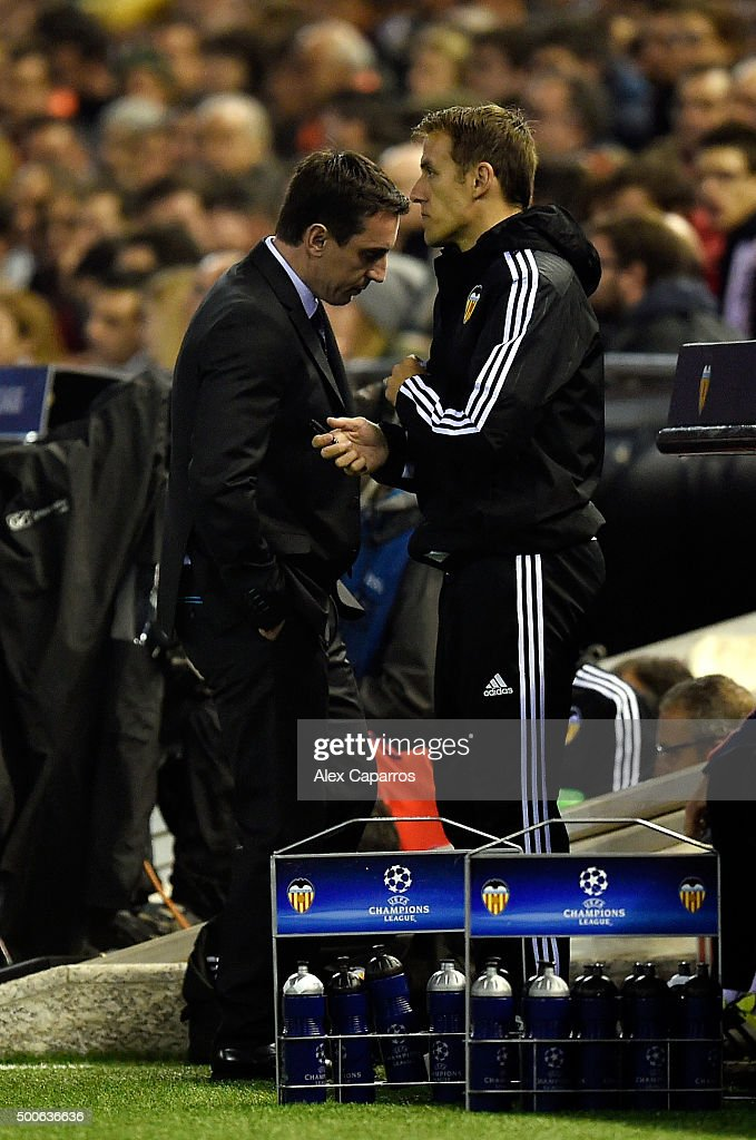 Gary Neville manager of Valencia and Assistant, Phil Neville react during the UEFA Champions League Group H match between Valencia CF and Olympique Lyonnais at Estadio Mestalla on December 9, 2015 in Valencia, Spain.