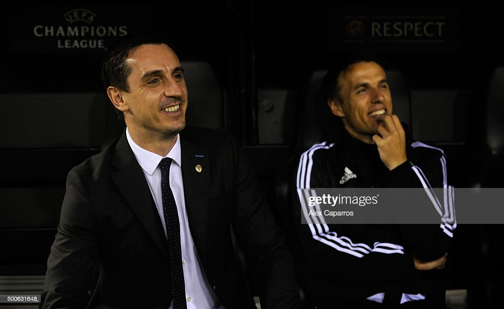 Gary Neville (L) manager of Valencia and Phil Neville assistant manager of Valencia look on from the bench prior to the UEFA Champions League Group H match between Valencia CF and Olympique Lyonnais at Estadio Mestalla on December 9, 2015 in Valencia, Spain.