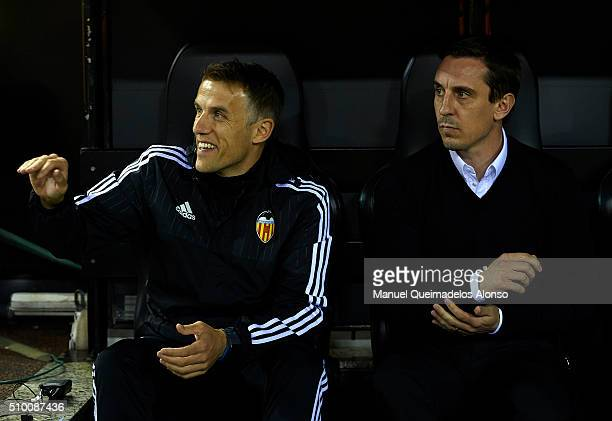 Gary Neville manager of Valencia and Phil Neville assistant manager of Valencia look on prior the La Liga match between Valencia CF and RCD Espanyol...