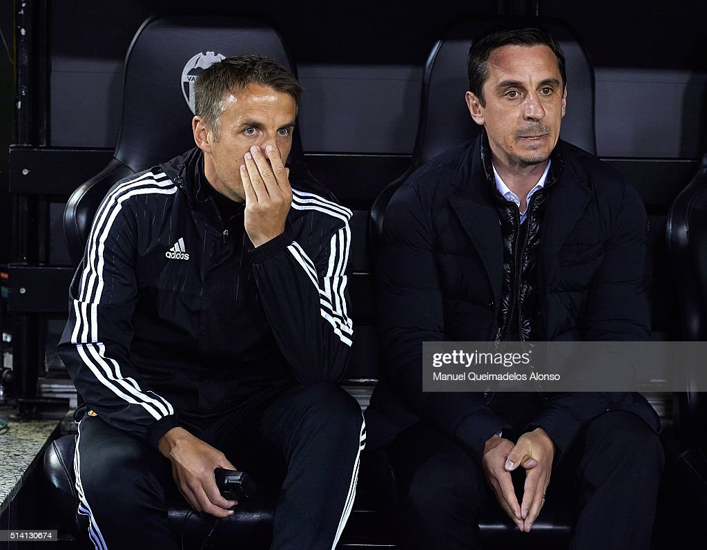 <a gi-track='captionPersonalityLinkClicked' href=/galleries/search?phrase=Gary+Neville&family=editorial&specificpeople=171409 ng-click='$event.stopPropagation()'>Gary Neville</a> (R) manager of Valencia and <a gi-track='captionPersonalityLinkClicked' href=/galleries/search?phrase=Phil+Neville&family=editorial&specificpeople=201898 ng-click='$event.stopPropagation()'>Phil Neville</a> assistant manager of Valencia talk prior to the La Liga match between Valencia CF and Atletico de Madrid at Estadi de Mestalla on March 06, 2016 in Valencia, Spain.