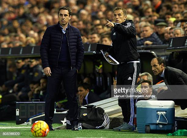 Gary Neville manager of Valencia CF and his assistant Phil Neville give instructions during the La Liga match between Valencia CF and Real Madrid CF...