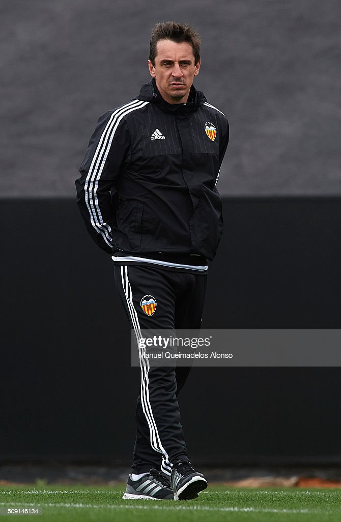 <a gi-track='captionPersonalityLinkClicked' href=/galleries/search?phrase=Gary+Neville&family=editorial&specificpeople=171409 ng-click='$event.stopPropagation()'>Gary Neville</a> manager of Valencia CF looks on during a training session ahead of Wednesday's Copa del Rey Semi Final, second leg match between Valencia CF and FC Barcelona at Paterna Training Centre on February 9, 2016 in Valencia, Spain.
