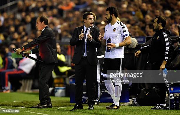 Gary Neville manager of Valencia speaks with Alvaro Negredo of Valencia during the UEFA Champions League Group H match between Valencia CF and...