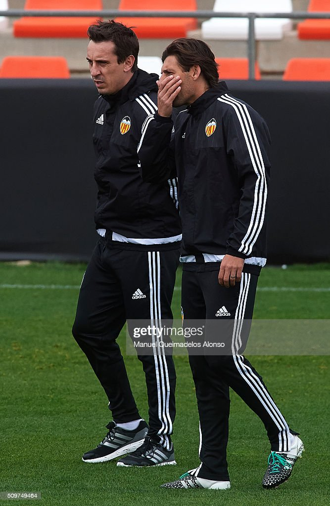 <a gi-track='captionPersonalityLinkClicked' href=/galleries/search?phrase=Gary+Neville&family=editorial&specificpeople=171409 ng-click='$event.stopPropagation()'>Gary Neville</a> (L) manager of Valencia talks to assistant manager <a gi-track='captionPersonalityLinkClicked' href=/galleries/search?phrase=Miguel+Angel+Angulo&family=editorial&specificpeople=653838 ng-click='$event.stopPropagation()'>Miguel Angel Angulo</a> during a training session ahead La Liga match between Valencia CF and RCD Espanyol at Paterna Training Centre on February 12, 2016 in Valencia, Spain.