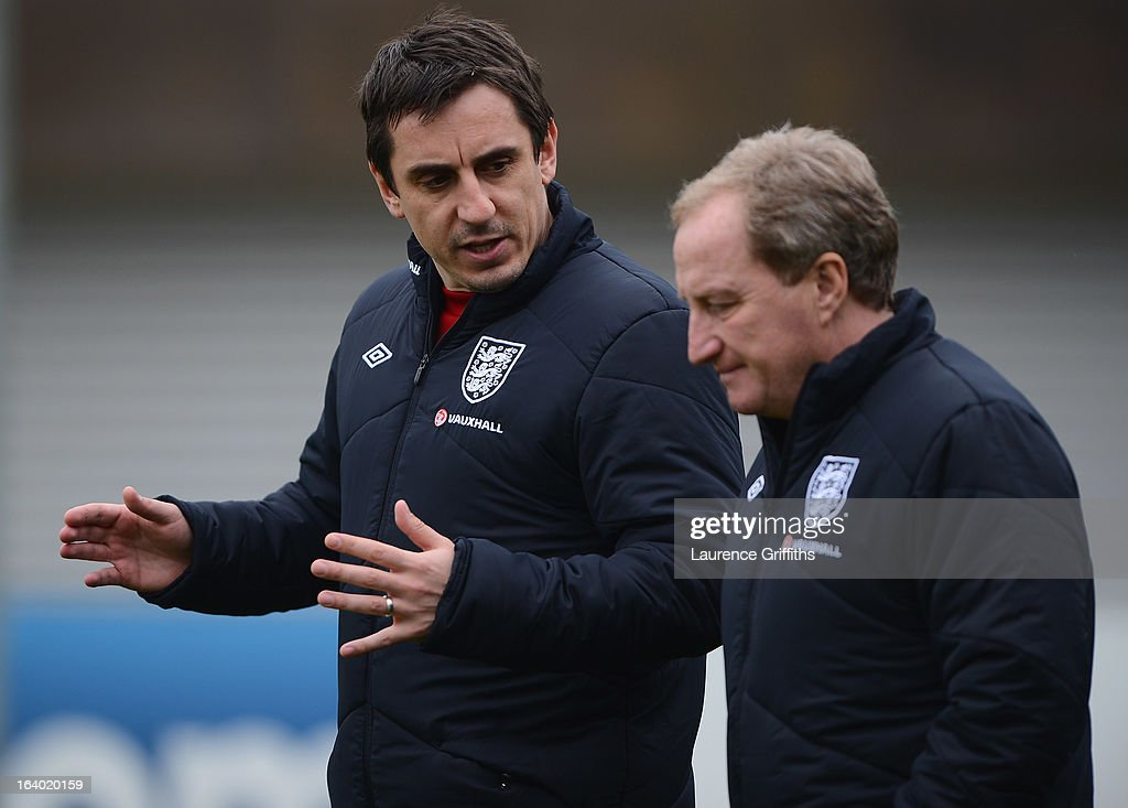 Gary Neville of England talks with Ray Lewington during a training session at St Georges Park on March 19, 2013 in Burton-upon-Trent, England.