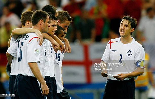 Gary Neville of England tells his team mates the order of the penalty takers prior to a penalty shootout during the FIFA World Cup Germany 2006...