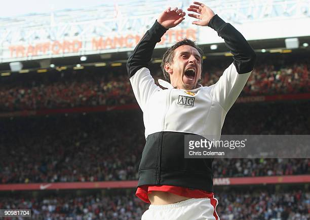 Gary Neville of Manchester United celebrates after the FA Barclays Premier League match between Manchester United and Manchester City at Old Trafford...