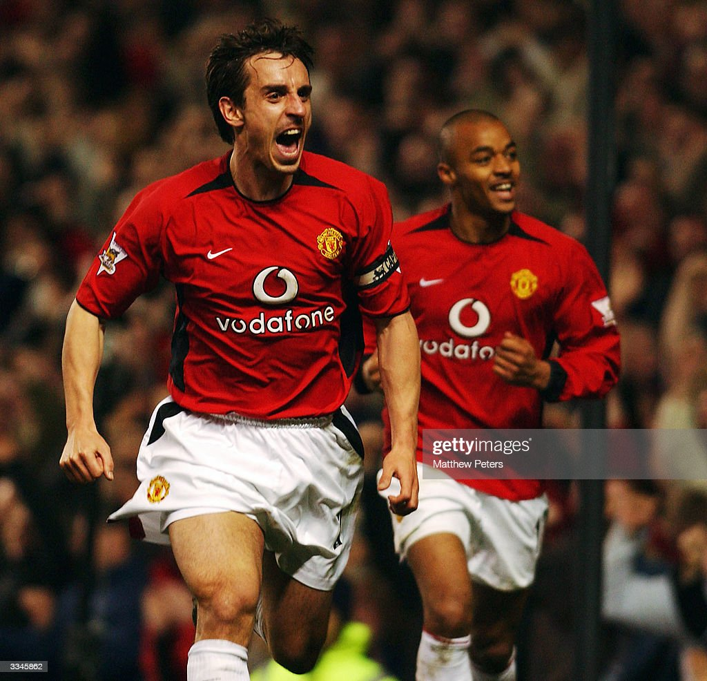 Gary Neville of Manchester United celebrates scoring the first goal with David Bellion during the FA Barclaycard Premiership match between Manchester United and Leicester City at Old Trafford on April 13, 2004 in Manchester, England.