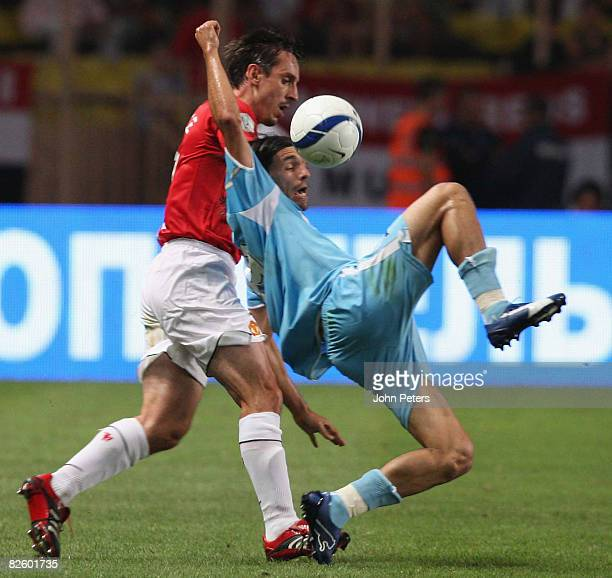 Gary Neville of Manchester United clashes with Danny of Zenit St Petersburg during the UEFA Supercup match between Manchester United and Zenit St...