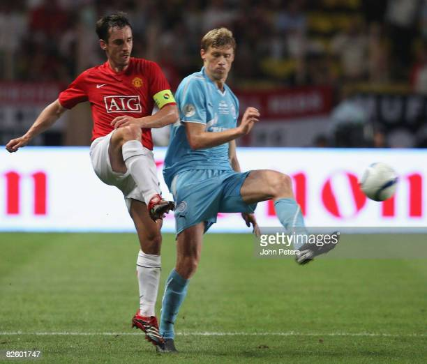 Gary Neville of Manchester United clashes with Pavel Pogrebnyak of Zenit St Petersburg during the UEFA Supercup match between Manchester United and...