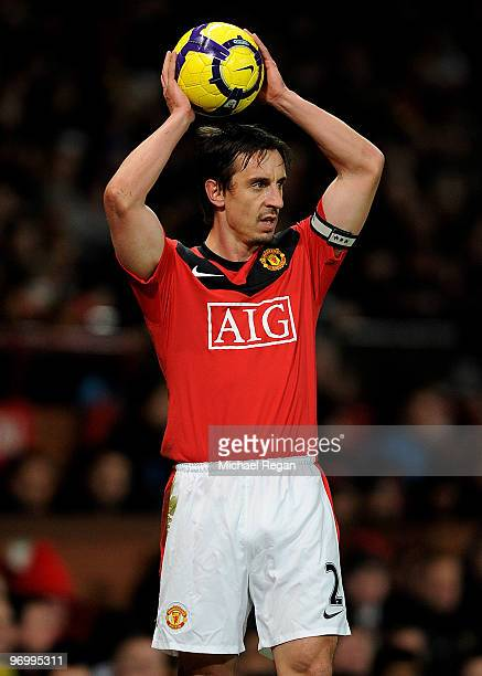 Gary Neville of Manchester United takes a throw in during the Barclays Premier League match between Manchester United and West Ham United at Old...