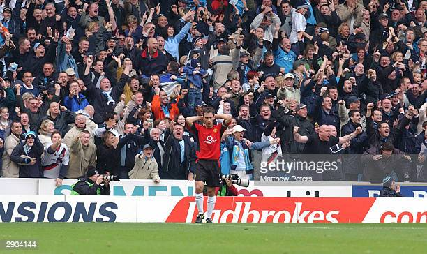 Gary Neville puts his hands over his head after letting Shaun Goater claim the ball and score City's second goal during the FA Barclaycard...