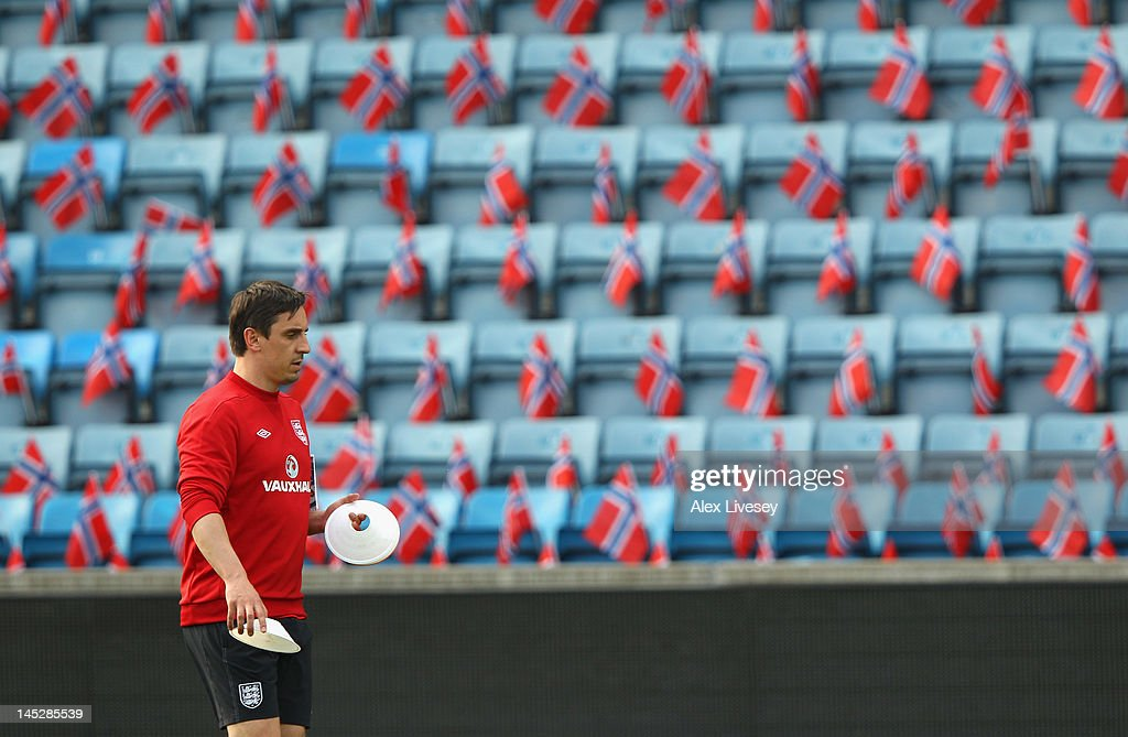 <a gi-track='captionPersonalityLinkClicked' href=/galleries/search?phrase=Gary+Neville&family=editorial&specificpeople=171409 ng-click='$event.stopPropagation()'>Gary Neville</a> the coach of England sets out cones during the England training session at the Ullevaal Stadion on May 25, 2012 in Oslo, Norway.