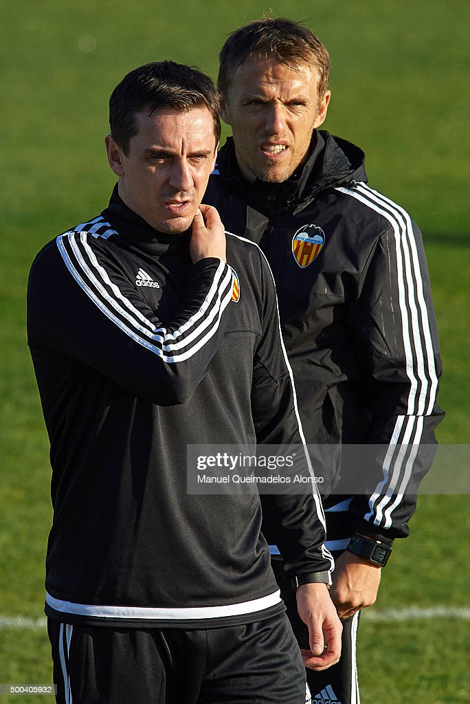 Gary Neville (L) the new manager of Valencia CF and Valencia CF assistant coach Phil Neville attend a training session ahead of Wednesday's UEFA Champions League Group H match against Olympique Lyonnais at Paterna Training Centre on December 08, 2015 in Valencia, Spain.