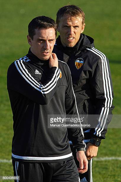 Gary Neville the new manager of Valencia CF and Valencia CF assistant coach Phil Neville attend a training session ahead of Wednesday's UEFA...