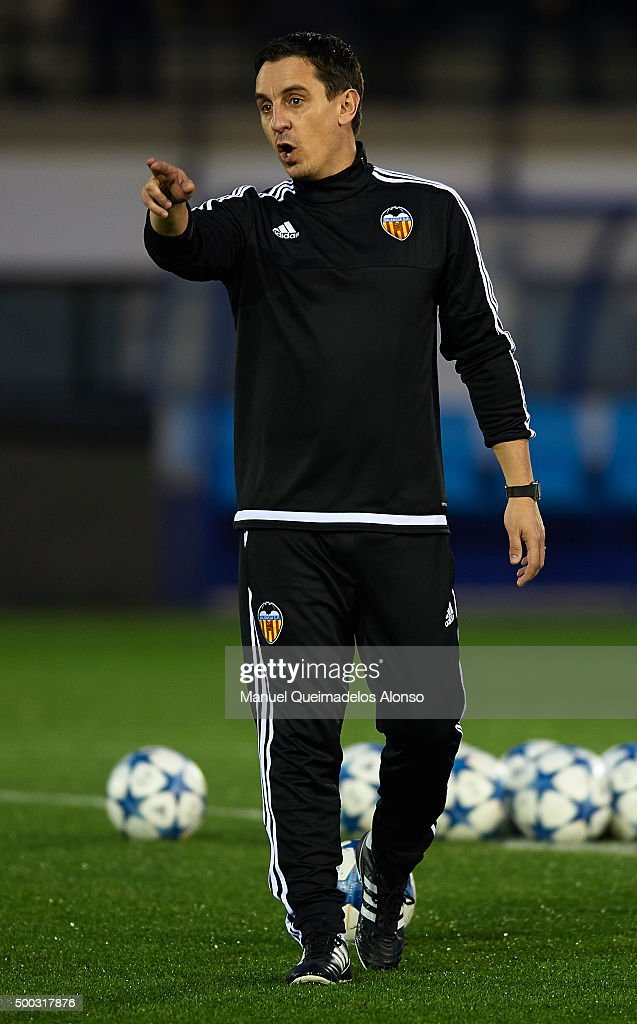 Gary Neville the new manager of Valencia CF gives instructions during a training session ahead of Wednesday's UEFA Champions League Group H match against Olympique Lyonnais at Paterna Training Centre on December 07, 2015 in Valencia, Spain.
