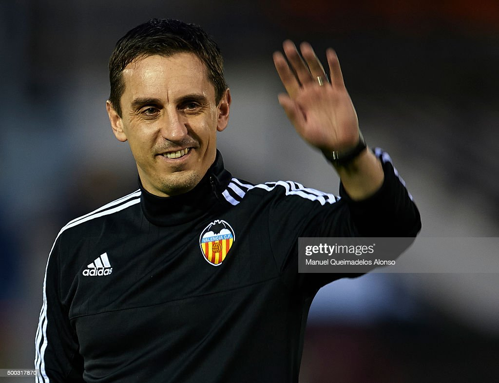 <a gi-track='captionPersonalityLinkClicked' href=/galleries/search?phrase=Gary+Neville&family=editorial&specificpeople=171409 ng-click='$event.stopPropagation()'>Gary Neville</a> the new manager of Valencia CF greets the fans during a training session ahead of Wednesday's UEFA Champions League Group H match against Olympique Lyonnais at Paterna Training Centre on December 07, 2015 in Valencia, Spain.