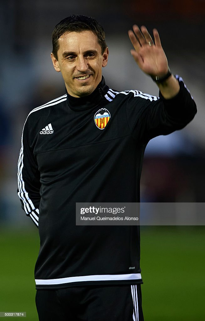 Gary Neville the new manager of Valencia CF greets the fans during a training session ahead of Wednesday's UEFA Champions League Group H match against Olympique Lyonnais at Paterna Training Centre on December 07, 2015 in Valencia, Spain.