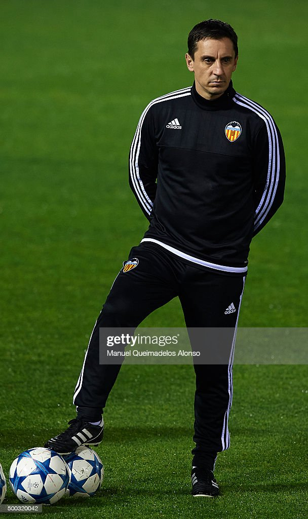 Gary Neville the new manager of Valencia CF looks on during a training session ahead of Wednesday's UEFA Champions League Group H match against Olympique Lyonnais at Paterna Training Centre on December 07, 2015 in Valencia, Spain.