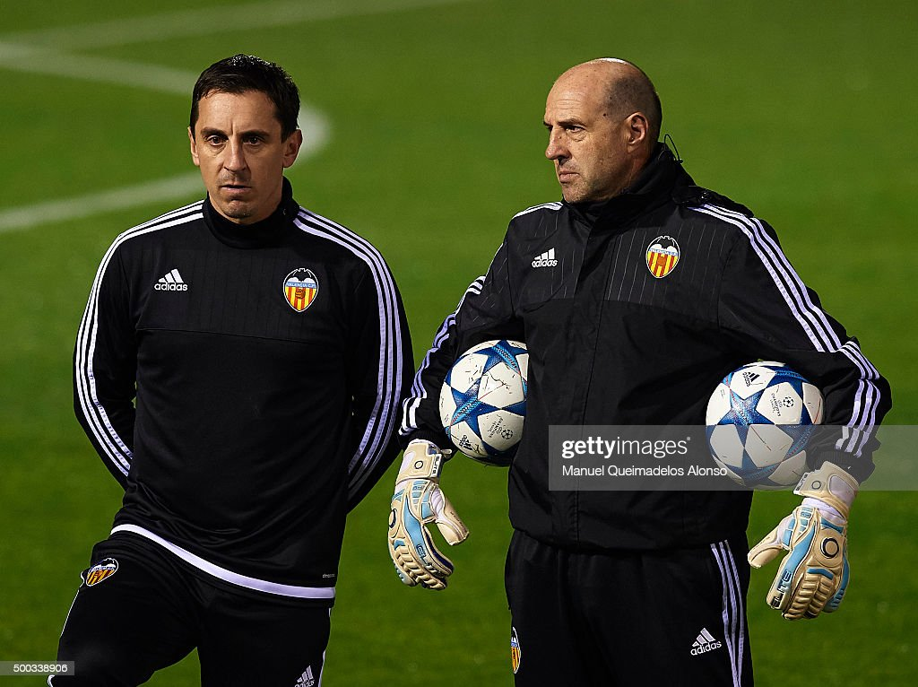 Gary Neville (L) the new manager of Valencia CF looks on with Valencia CF Assistant goalkeeper coach Jose Manuel Ochotorena during a training session ahead of Wednesday's UEFA Champions League Group H match against Olympique Lyonnais at Paterna Training Centre on December 07, 2015 in Valencia, Spain.