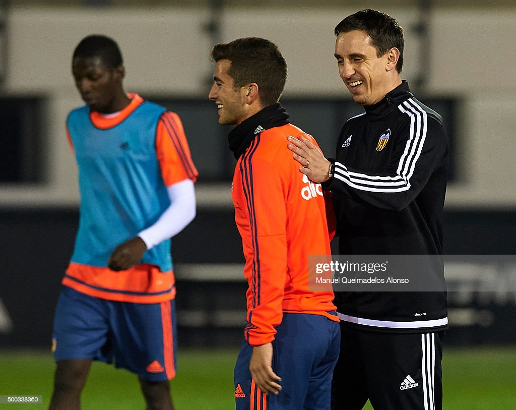 Gary Neville (R) the new manager of Valencia CF reacts to his player Jose Gaya during a training session ahead of Wednesday's UEFA Champions League Group H match against Olympique Lyonnais at Paterna Training Centre on December 07, 2015 in Valencia, Spain.