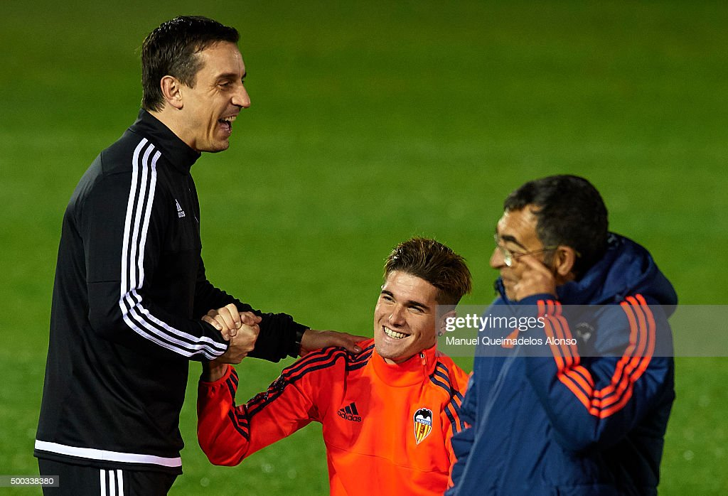 Gary Neville the new manager of Valencia CF reacts with his player Rodrigo De Paul during a training session ahead of Wednesday's UEFA Champions League Group H match against Olympique Lyonnais at Paterna Training Centre on December 07, 2015 in Valencia, Spain.