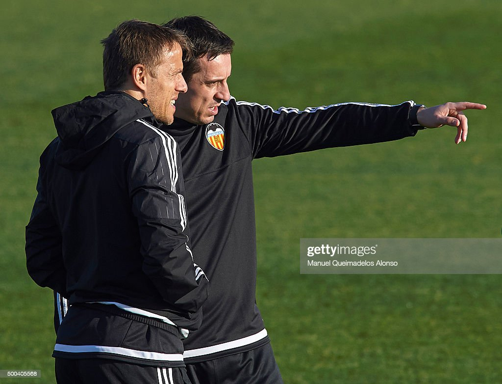 <a gi-track='captionPersonalityLinkClicked' href=/galleries/search?phrase=Gary+Neville&family=editorial&specificpeople=171409 ng-click='$event.stopPropagation()'>Gary Neville</a> (R) the new manager of Valencia CF talks to Valencia CF assistant <a gi-track='captionPersonalityLinkClicked' href=/galleries/search?phrase=Phil+Neville&family=editorial&specificpeople=201898 ng-click='$event.stopPropagation()'>Phil Neville</a> during a training session ahead of Wednesday's UEFA Champions League Group H match against Olympique Lyonnais at Paterna Training Centre on December 08, 2015 in Valencia, Spain.