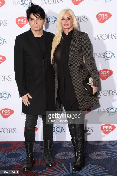 Gary Numan and Gemma O'Neil attend the Ivor Novello Awards at Grosvenor House on May 18 2017 in London England