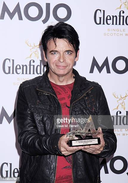 Gary Numan poses in front of the winners boards after winning the MOJO Inspiration Award at the Glenfiddich Mojo Honours List 2011 awards ceremony at...