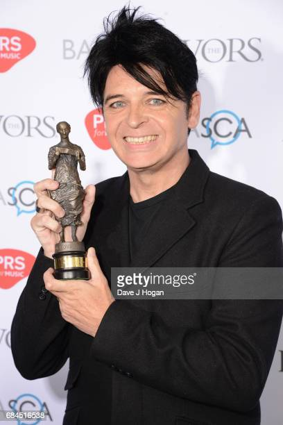 Gary Numan poses in the winners room with the Ivors Inspiration Award at the Ivor Novello Awards at Grosvenor House on May 18 2017 in London England